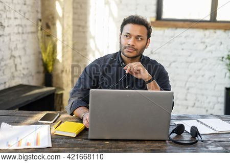 Smart And Clever Multiracial Male Entrepreneur Thinks About Way To Develop His Startup, Thoughtful I