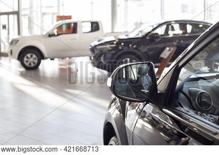 New Modern Unknown Cars At Dealer Showroom. Car Auto Dealership. Prestigious Vehicles. Themed Blur B