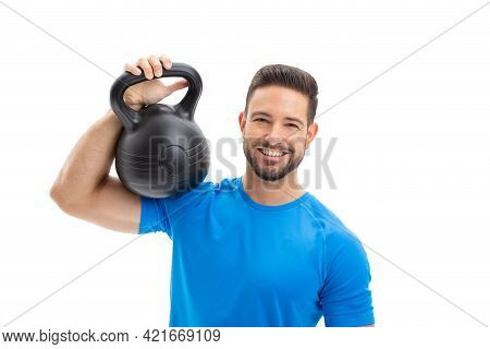 Happy Young Caucasian Man With Toothy Smile Holding Kettlebell On Shoulder, Isolated On White Backgr