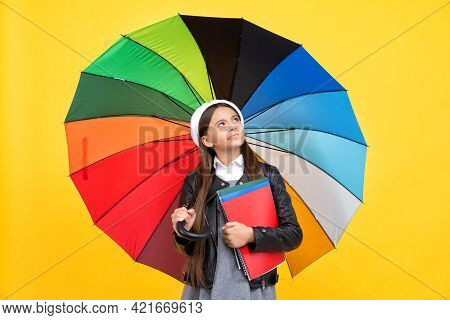 Happy Girl In Glasses Hold Notebook. Education. Teen Child Under Colorful Parasol.
