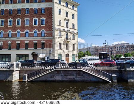 Saint Petersburg, Russia - May 24, 2021. Descent To The Water On The Griboyedov Canal, Flooded By Fl