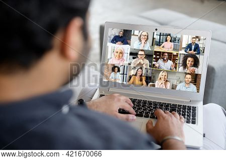 Young Businessman Using Laptop App For Video Connect With Colleagues, Takes Part In Video Conference