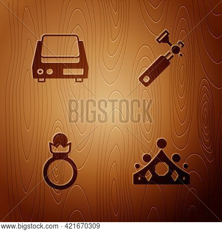 Set King Crown, Electronic Jewelry Scales, Diamond Engagement Ring And Jewelers Lupe On Wooden Backg