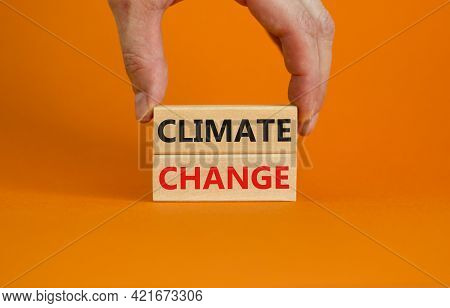 Climate Change Symbol. Wooden Blocks With Words 'climate Change' On Beautiful Orange Background. Bus