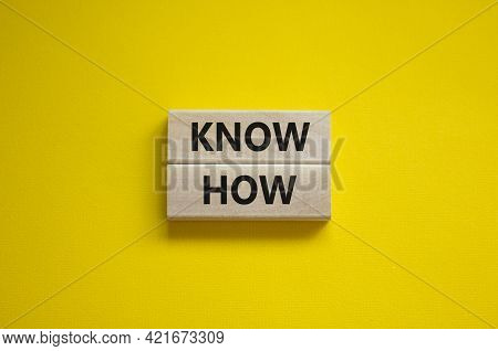 Know How Symbol. Wooden Blocks With Words 'know How' On Beautiful Yellow Background, Copy Space. Bus
