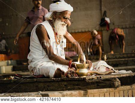 Varanasi, India - November 01, 2016: Portrait Of A Hindu White Bearded Old Man Sadhu, Pilgrim In Whi