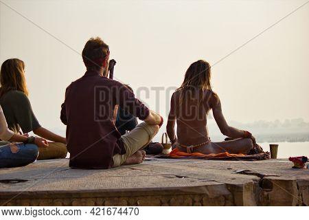 Varanasi, India - November 01, 2016: Bunch Of Tourists, Sadhu Baba And Pilgrims In Sitting Posture M