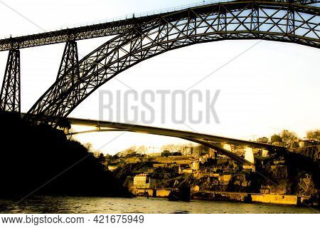Beautiful And Colossal Iron Bridges Called Maria Pia And Ponte Do Infante Over The Waters Of The Dou
