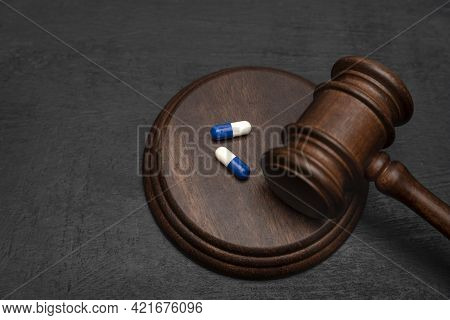 Judge Gavel And Pills. Litigation Medicine-related Healthcare In Pharmaceuticals. Law In Medicine