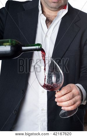 Man Pouring A Glass Of Red Wine