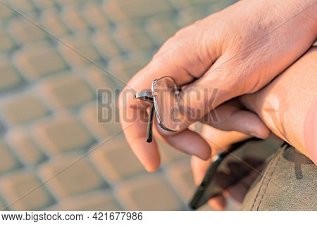 Female Hands Holds Phone And Glasses In The City's Park. Eyeglasses. Outdoor. Smartphone. Women. Vis
