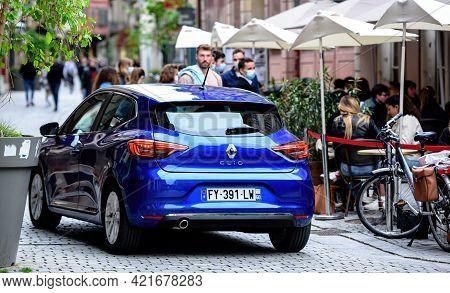 Strasbourg, France - May 19, 2021: Renault Car In Front Of Terrace Of Academie De La Biere On Pedest