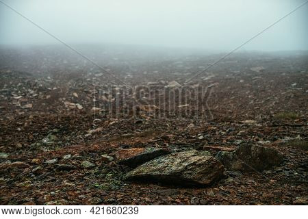 Stone Field In Dense Fog In Highlands. Empty Stone Desert In Thick Fog. Zero Visibility In Mountains