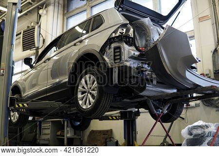 Moscow Russia - May 25 2021: Modern Suv Car In A Car Service On A Lift. The Rear Bumper Is Removed F