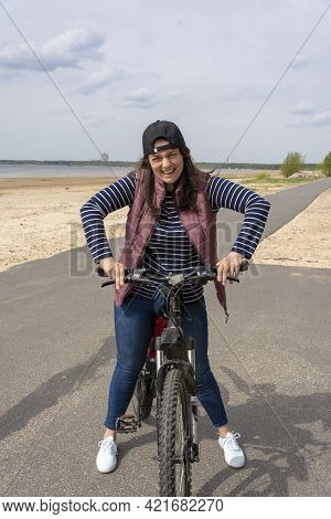 A Woman On A Bicycle, Riding A Bicycle, A Bike Path And A Young Pretty Woman With A Bicycle, A Europ