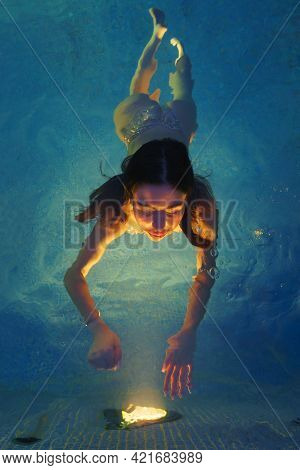 Brunette Female Swimming In Spa Pool With Geothermal Water. Beautiful Bather Reaches Out With Her Ha