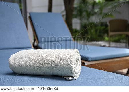 Brown Pool Towels Are Rolled Up And Placed On A Sunbed By The Pool In A Pool Villa In A Luxury Hotel