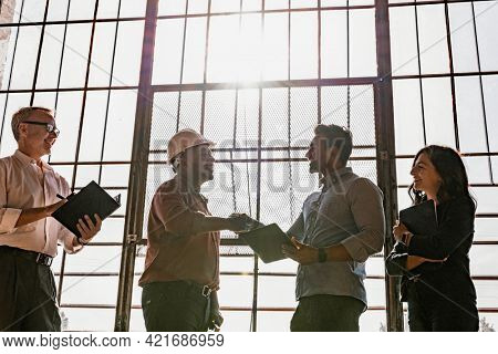 Business people greeting by shake hands
