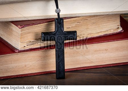Faith, Religion And Belief. Rescue And Support Concept. Stack Of Books And Wooden Cross