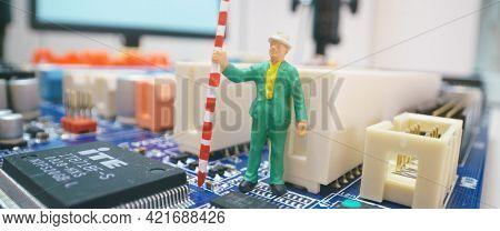 Miniature repair man on mainboard, Miniature figure of worker team try to repair cpu on mainboard.