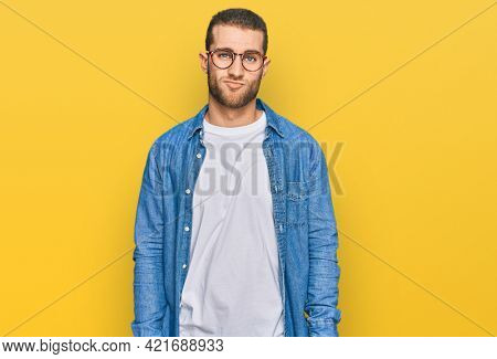 Young caucasian man wearing casual clothes looking sleepy and tired, exhausted for fatigue and hangover, lazy eyes in the morning.