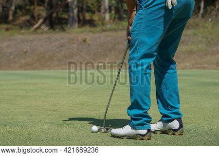 Golfers Are Putting Golf In The Evening Golf Course Golf Backglound. Golfer Hitting Golf Ball. Sport