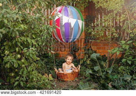 Preschool Boy Traveling. Child Playing In Pretend Hot Air Balloon. Happy Kid Boy Having Fun Flying U