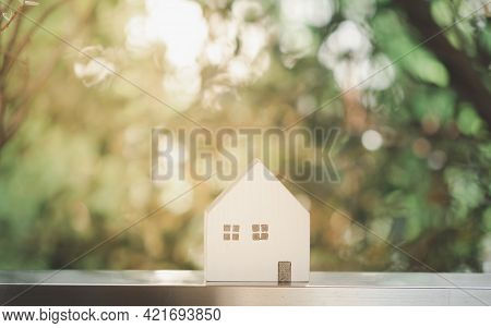 Wooden Miniature House With Beautiful Nature Background. Concept Of Buying A House, Real Estate Mark