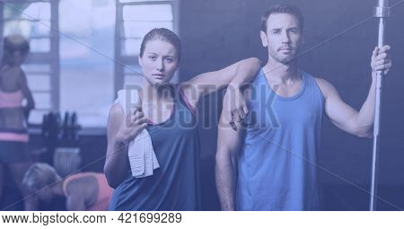 Composition of man and woman in fitness class. sport, fitness and active lifestyle concept digitally generated image.