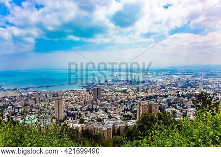 The magnificent city of Haifa. View from Mount Carmel to the international seaport of Haifa. Sunny day by Mediterranean Sea.