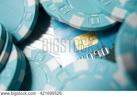 Casino chips and credit card on a table.