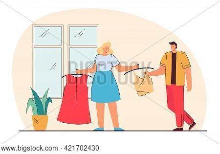 Woman Showing New Clothes To Man. Wife Showing New Top And Dress To Husband. Clothes Shopping. Shopp