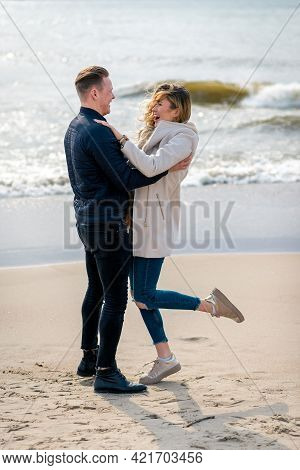 Young Couple Enjoying On A Sand And Enjoying Each Other.summer,spring,autumn Vacation.