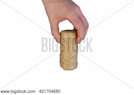 A Man Is Holding A Roll Of Twine. Hand With Coiled Twine Isolated On White Background.