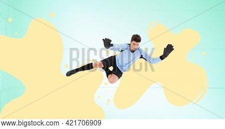 Composition of football goalkeeper over yellow splodges and blue background. sports event and competition concept digitally generated image.