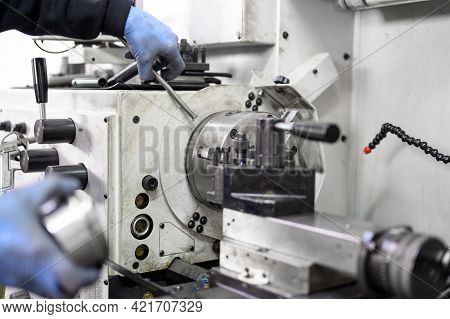 Close Up View Of Worker Operating A High Precision Turning Operation On A Multi Axis Lathe, Cnc Mach