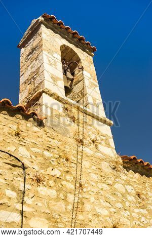 Detail Of Architecture Stone Traditional Belfry In Vathia Old Town, Mani Peloponnese Greece. Archite