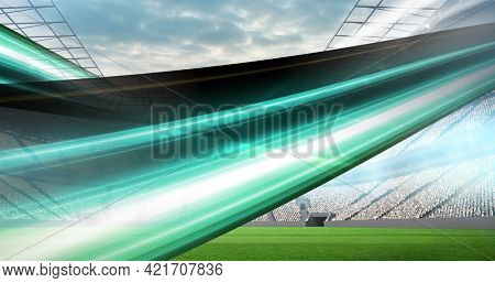 Composition of green trails over sports stadium. sport event and competition concept digitally generated image.