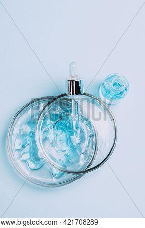 Cosmetics Liquid Gel Serum Lubricant Hyaluronic Acid With Oxygen Bubbles Of Glass Laboratory Glasswa