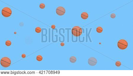 Composition of multiple basketballs over blue background. sport event and competition concept digitally generated image.