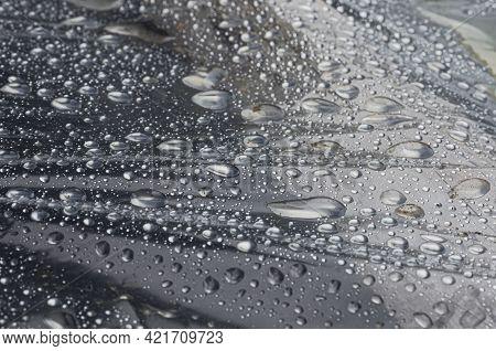 Shiny Surface Of Polyethylene After Rain Close-up