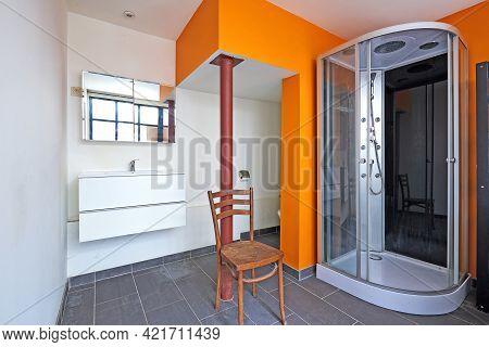 Washroom And Shower Room In Loft With Orange Wall