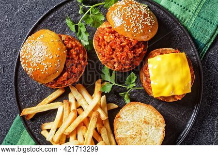 Homemade Bbq Sloppy Joe Sandwiches With French Fries On A Black Plate, Flat Lay, Close-up, American