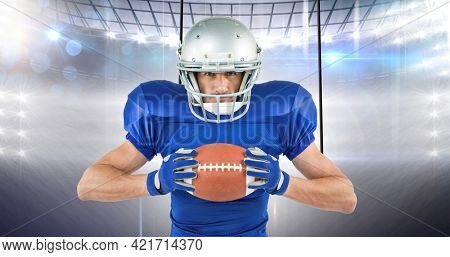 Composition of male rugby player with ball over rugby field. sport, fitness and active lifestyle concept digitally generated image.