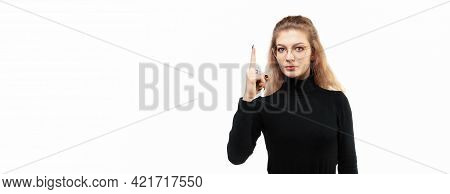Blonde Girl Feeling Like A Genius Holding Index Finger Proudly Up In The Air After Realizing A Great