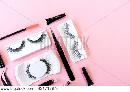 Various Tools For Eye Lash Extensions On A Trendy Pastel Pink Background. Concept. Eyelash Curler, T