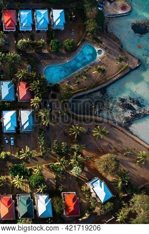 Aerial View Of The Cabins And Pool From A Bird's Eye View On The Island Of Mauritius.