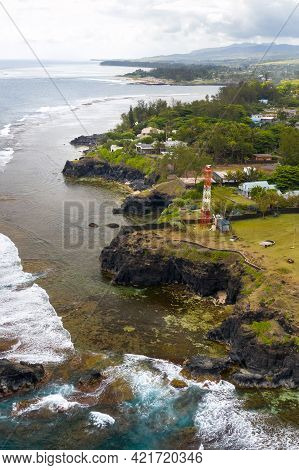 View Of The Famous Golden Beach Between Black Volcanic Rocks On The Banks Of The Gris-gris River, La