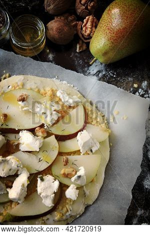 Cooking Pizza With Pears, Cheeses And Walnuts. Pizza Before Baking.