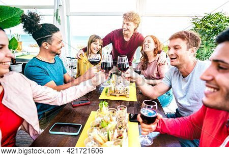 Happy Millenial People Having Fun Together Drinking Wine At Terrace  On Private House Party - Young
